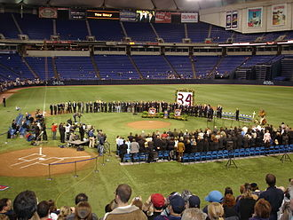 "Kirby Puckett - Former manager Tom Kelly surrounded by former teammates Dan Gladden, Jim ""Mudcat"" Grant, and Kent Hrbek, Hall of Famer Harmon Killebrew, and friends at the Memorial at the Metrodome on March 12, 2006"