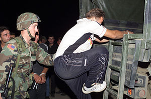 National Liberation Army (Macedonia) - U.S. soldier loading up NLA fighters on a truck heading to a detention center.