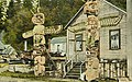 Kwakiutl thunderbird totem poles and house belonging to Nimpkish Chief Tlah-Co-Glass, Alert Bay, British Columbia, circa 1923 (AL+CA 2105).jpg