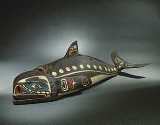 Kwakwaka'wakw art -  Kwakwaka'wakw. Baleen Whale Mask, 19th century. It is known to have one of the most distinctive forms of northwest coast art. Masks like this are owned by a particular person who has inherited the rights to make, wear, and perform with it during potlatch ceremonies, elaborate communal celebrations. The mask is worn along the dancer's back while he imitates the swimming and diving of the whale by manipulating cords to move the flippers, tail, and jaw. Others sing, shake rattles, and drum during the presentation. Such performances reaffirm and validate the owner's rights to their clan's history, honor their ancestors, and bring the mask to life. Brooklyn Museum