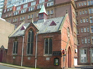 French Protestant Church, Brighton - Side view of the church, with the Metropole Hotel behind