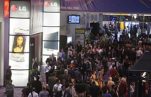 Attendees walking by the LG Electronics displa...