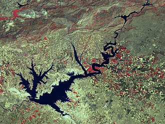 Economy of Turkey - Atatürk Dam is the largest of the 22 dams in the Southeastern Anatolia Project. The program includes 22 dams, 19 hydraulic power plants, and the irrigation of 1.82 million hectares of land. The total cost of the project is estimated at $32 billion. The total installed capacity of power plants is 7476 MW and projected annual energy production reaches 27 TWh.
