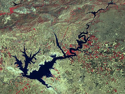 Ataturk Dam is the largest of the 22 dams in the Southeastern Anatolia Project. The program includes 22 dams, 19 hydraulic power plants, and the irrigation of 1.82 million hectares of land. The total cost of the project is estimated at $32 billion. The total installed capacity of power plants is 7476 MW and projected annual energy production reaches 27 TWh. Landsat ataturk 24aug02 57m.jpg
