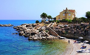 Lapithos - A beach and a house standing by it in Lapithos. Tourism is an important source of income for the town.