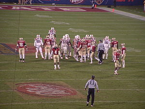 2010 ACC Championship Game - The two teams line up for the final play of the game.  Virginia Tech quarterback Tyrod Taylor kneeled with the ball to run out the clock and end the game.