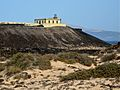 Light house on a cliff at Isla de Lobos.jpg