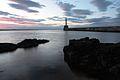 Lighthouse and rocks (4768145757).jpg