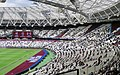 London Stadium Hands Face Space.jpeg