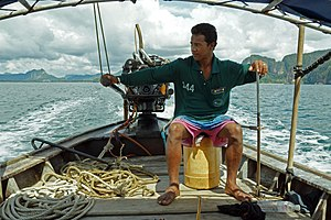 Long-tail boat driver.jpg
