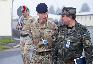 Mark Poffley - Poffley with a Ukrainian officer during Exercise Combined Endeavor in 2014