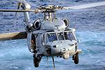 MH-60S Sea Hawk transports cargo at sea 130221-N-QI595-056.jpg
