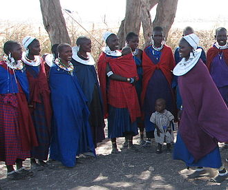 Heritage commodification - Maasai women and children in Kenya.