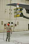 Maintenance airman 'tags' tanker 131002-F-GR156-178.jpg