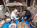 Mallah men selling fishes.jpg