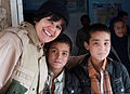 Marissa Smith, a U.S. Army Corps of Engineers Portland District employee deployed to Afghanistan, stands for a photo with boys at the Tahya-e-Maskan Orphanage in Kabul, Afghanistan, Jan. 14, 2012, while 120114-A-ZT118-506.jpg