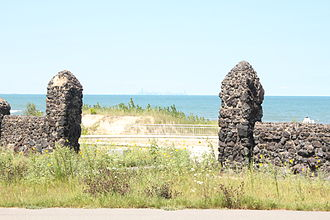 Marquette Park (Gary) - Old stone gates, modern beach access, and Chicago skyline in the distance