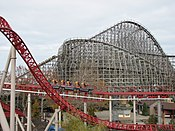 An overview of the Mean Streak roller coaster in the background with the Maverick roller coaster in the foreground