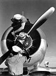 Mechanics check engine of SNJ at Kingsville Field, NATC, Corpus Christi, Texas HD-SN-99-02495.jpg