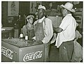 Mexican and negro cotton pickers inside plantation store, Knowlton Plantation, Perthshire, Miss. Delta. This transient labor is contracted for and brought in trucks from Texas each season. October 1939.jpg