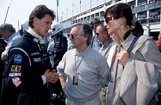 Bernie Ecclestone - Michael Schumacher meeting Ecclestone in September 1991 at a sportscar race at Magny-Cours, France (Ecclestone's then-wife Slavica on the right)