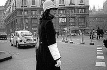 53d54e8345b4e Italian policewoman wearing tall pith helmet
