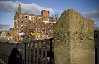 """Altrincham - A milestone along the Barton Bridge and Moses Gate turnpike road near Eccles, showing the spelling of """"Altringham"""""""