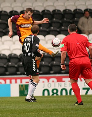 Volley (football) - A Motherwell player volleys the ball in a match against St Mirren.
