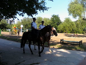 Law enforcement in Moldova - Mounted Moldovan police in a park.