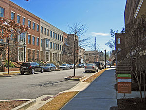 Street with midrise multifamily housing in Gle...
