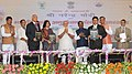 Narendra Modi witnessing the exchange of MoU among the Union Ministry of Steel, Government of Jharkhand and NMDC Ltd. to setup a new Steel Plant, in Hazaribagh, Jharkhand. The Union Minister for Agriculture (1).jpg