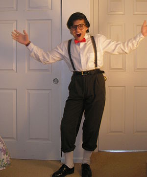 Nerd - A child dressed up as a stereotypical nerd