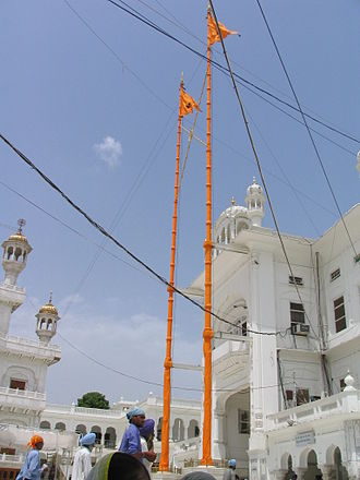 Gurdwara - Nishan Sahib flags on poles at Harmandir Sahib, Amritsar.
