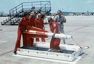 AIM-4 Falcon - 119th Fighter Wing weapons handlers with an AIM-4C, 1972.