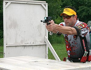 Practical shooting - An Open division competitor during a stage.