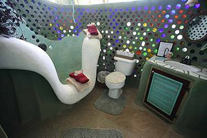 Autonomous building - The bathroom of an Earthship, featuring a recycled bottle wall