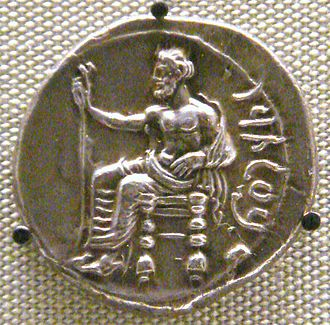 Achaemenid coinage - Silver stater of Pharnabazus as Satrap of Cilicia (379-374 BCE), depicting a seated Baaltars. British Museum.