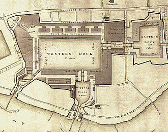 "Tobacco Dock - Plan drawing of London Docks in 1831. Tobacco Dock is the large almost-square building marked ""Tobacco Warehouse"". Most of the docks have since been filled in."