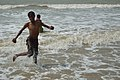 Playful Boy with Sea Waves - New Digha Beach - East Midnapore 2015-05-03 9812.JPG