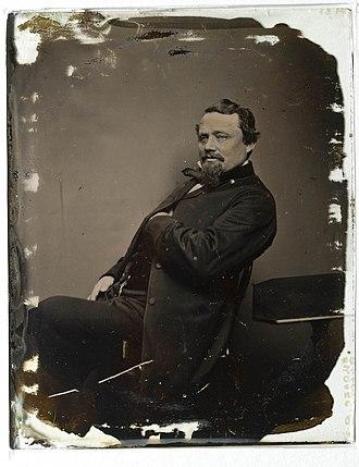 Ambrotype - Image: Porträtt av man, sittande med vänstra handen stucken inannför rocken Nordiska Museet NMA.0052940 1