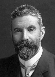 Portrait of Alfred Deakin seated at his desk (cropped).jpg