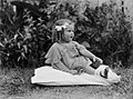 Portrait of a toddler girl seated on the grass (AM 85180-1).jpg