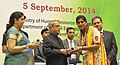 Pranab Mukherjee presenting the National Award for Teachers-2013 to Smt. Nirjla Kumari, Himachal Pradesh, on the occasion of the 'Teachers Day', in New Delhi. The Union Minister for Human Resource Development.jpg