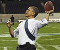 President Barack Obama throws a football (cropped2).jpg