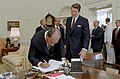 President Sadat of The Arab Republic of Egypt Signs Guest Book As President Ronald Reagan Looks on in The Oval Office.jpg