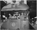 President and Mrs. Harry S. Truman, Margaret Truman, and two unidentified men stand on the rear platform of the... - NARA - 199966.tif