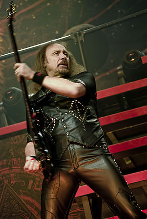 Heavy metal bass - Bass guitarist Ian Hill from the heavy metal band Judas Priest. A red pick can be seen in his plucking hand.
