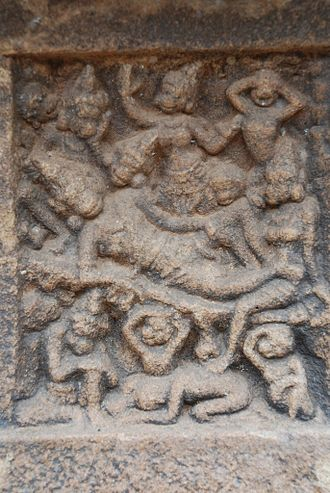 Tara (Ramayana) - The miniature panel in the Tirupullamangai Temple, Pasupathikoil captures the scene of Valli's death. Tara, depicted with a monkey face, is seated at his feet, lamenting his death.