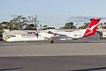 QantasLink (VH-QOU) Bombardier DHC-8-402Q taxiing at Wagga Wagga Airport 1.jpg