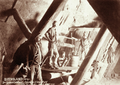 Queensland State Archives 2250 Four miners at head of winze Columbia and Smithfield at Gympie Goldfield 775 feet level c 1897.png